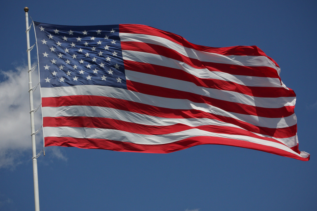 should burning an american flag be a criminal offense? | norville rogers